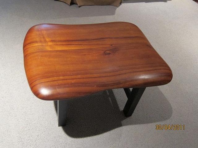Koa footstool or stool. Koa is a beautiful, pricey wood that glows when polished.