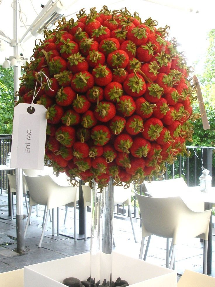 "Eat me - strawberry floral display. What a great design for the dessert display. Can out next to a tray of little champagne cups that say ""drink me"". #loveAlice"