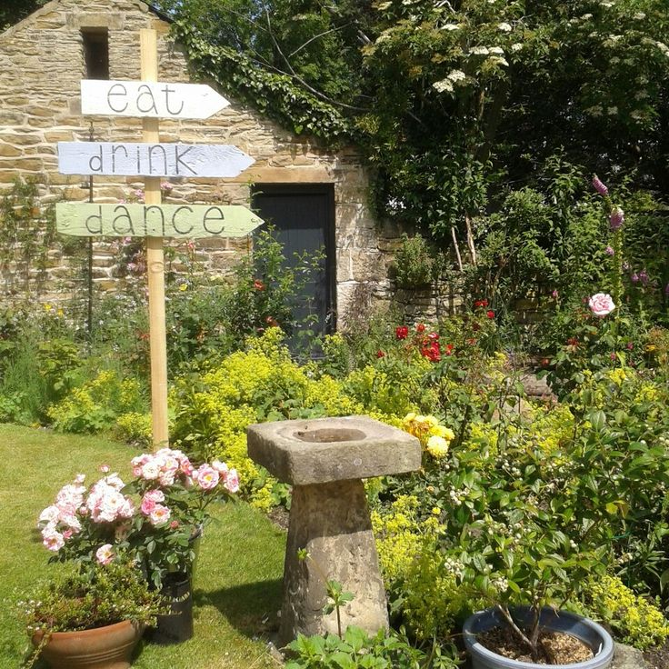 One of our rustic signs sitting in the prettiest garden.