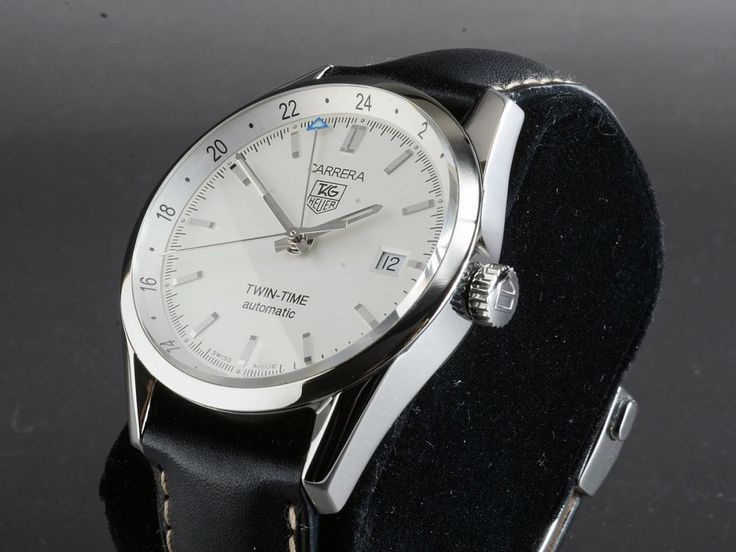 TAG Heuer Carrera Twin Time Automatik GMTReference: WV2116Mechanism: AutomatikCase: SteelStrap: LeatherVery Good Condition (1)with box and documentsDiameter: 39 mmGlass: Sapphire12 months warrantyDate, GMTDisplay Back, Center Seconds, Luminescent Numerals, Luminescent Hands