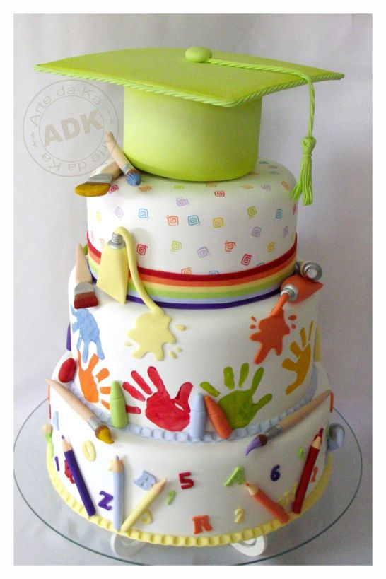 Cute tiered graduation cake for Kinders ... colorful and with grad cap as topper too fro Arte da Ka