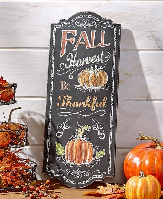 Decorate for the harvest season with this colorful wall art. Its chalkboard-style design combines a variety of harvest ideas and imagery. Ready to hang. Details: - Hang it or lean it against a wall -
