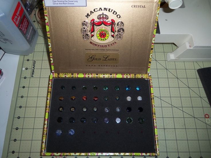 If you have stretched ear lobes or other piercings that use plug type jewelry, a cheap and useful jewelry box can be made from a cigar box and a foam insert.  This also keeps the plugs captive in the event that the box gets dropped, so they don't get lost / chipped / shattered.  Simply mark where each plug goes and cut a small X with a sharp hobby knife to make a pocket.