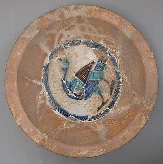 Bowl  Date:     12th century Geography:     Syria Medium:     Earthenware; glazed Dimensions:     H. 3 3/8 in. (8.6 cm) Diam. 13 3/4 in. (34.9 cm) Classification:     Ceramics Credit Line:     H. O. Havemeyer Collection, Gift of Horace Havemeyer, 1929 Accession Number:     29.160.10