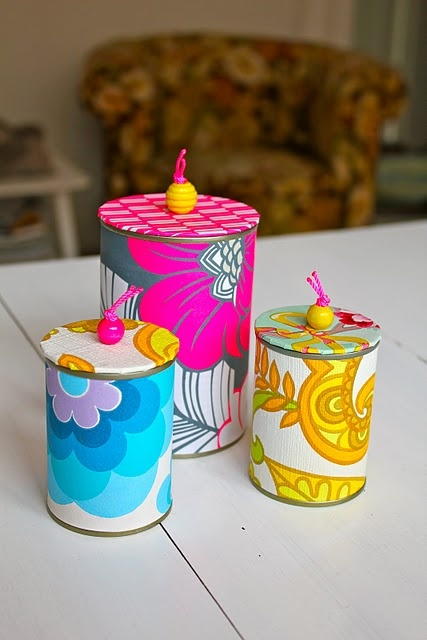 Tin cans covered in paper with cardboard and bead lids - resulting in a beautiful (and useful) gift