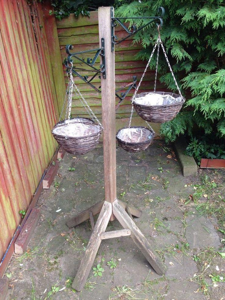 25 best ideas about hanging basket stand on pinterest live basket garden makeover and pebble. Black Bedroom Furniture Sets. Home Design Ideas