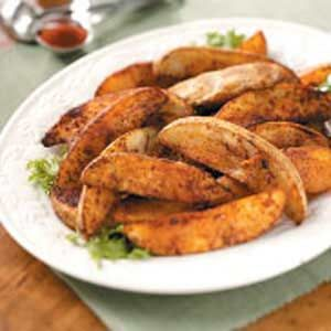 Chili-seasoned potato wedges. Use the small baking potatos and cut the ingredients by1/3-1/2 and it's WW 2pts.