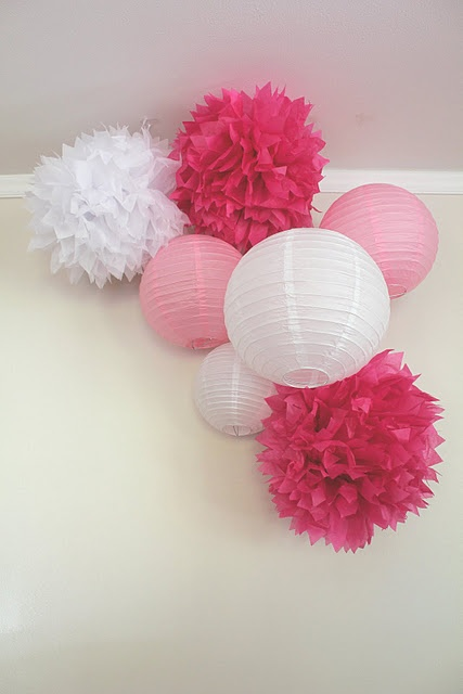 pink tissue pom poms and paper lanterns