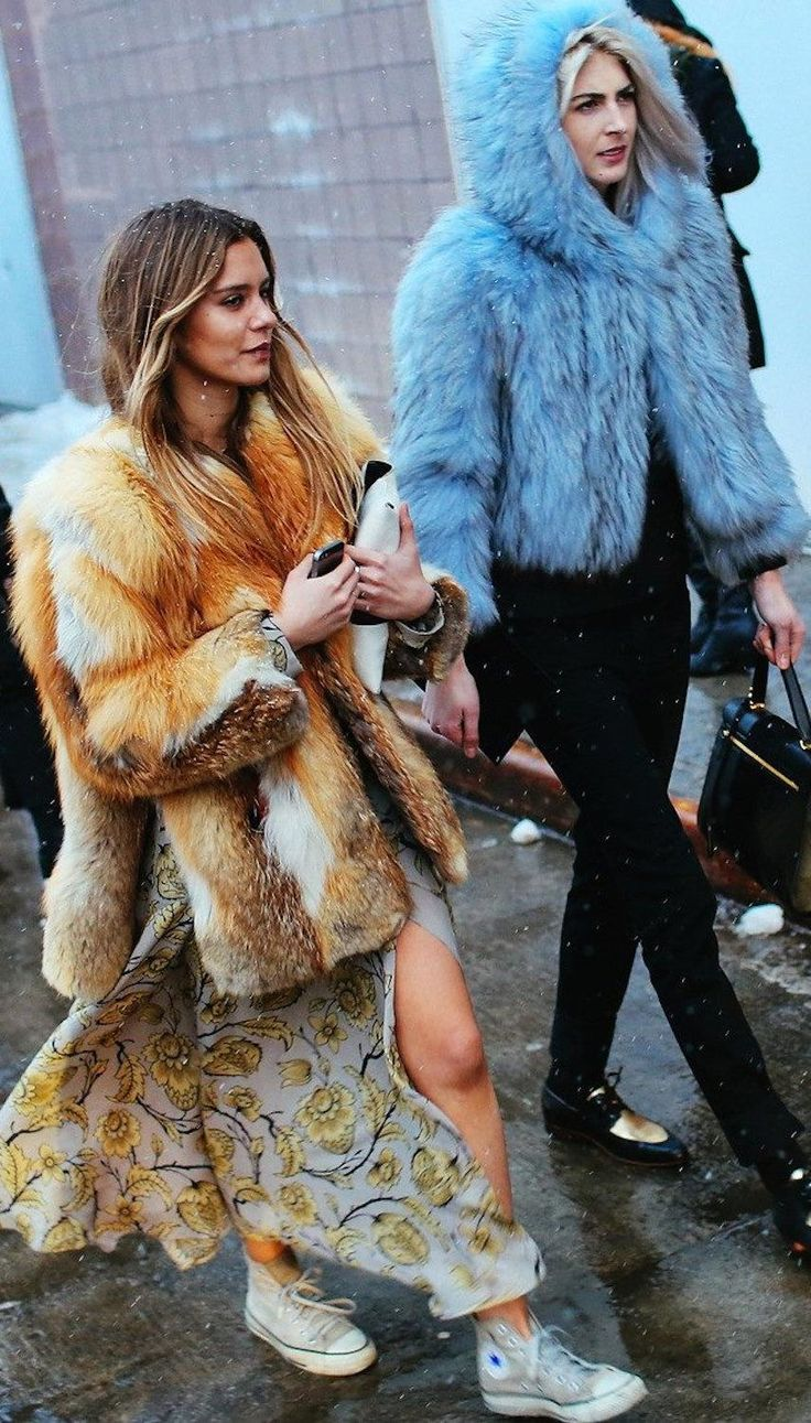Vogue's Emma Morrison and Kelly Connor in blue and brown furs with bronde hair