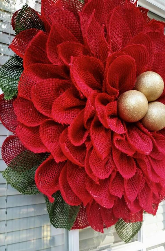 **** PLEASE READ THE FULL DESCRIPTION BEFORE ORDERING*** **All wreaths are made to order** ***PLEASE READ PROCESSING TIME*** This listing is for a red burlap poinsettia wreath. Red petals with three gold glitter ornaments in the center. Fabric is treated with stiffener but it may fray slightly in places as that is the nature of the fabric. Completed wreath dimensions are approximately 20 to 22 inches wide and approximately 2-4 inches deep. Built on a sturdy wire frame and backed with…