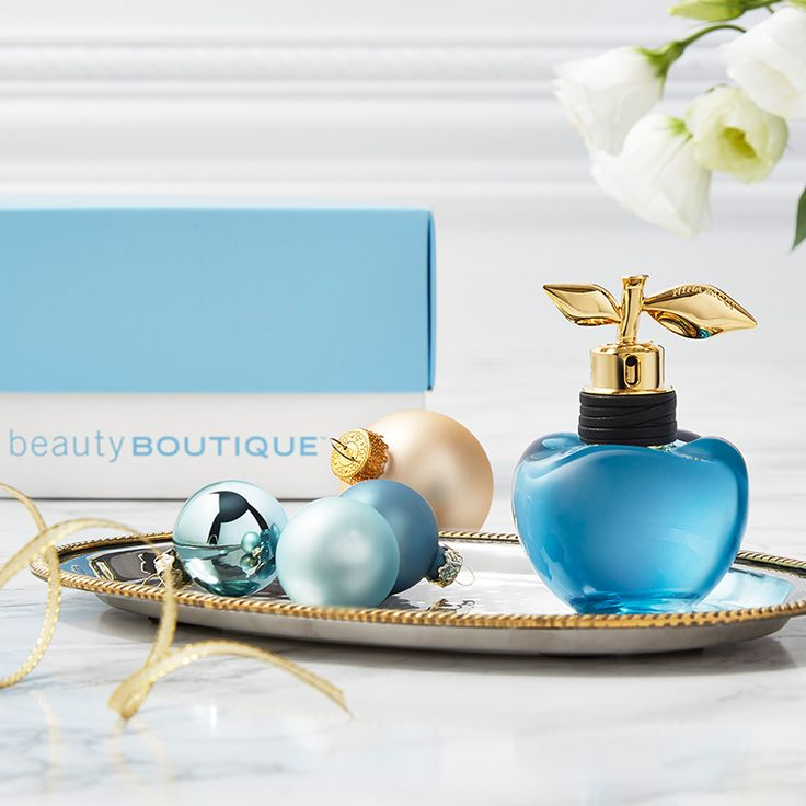 A touch of blue for the holidays can smell so sweet. Give the gift of passion with Nina Ricci's Luna eau de toilette.