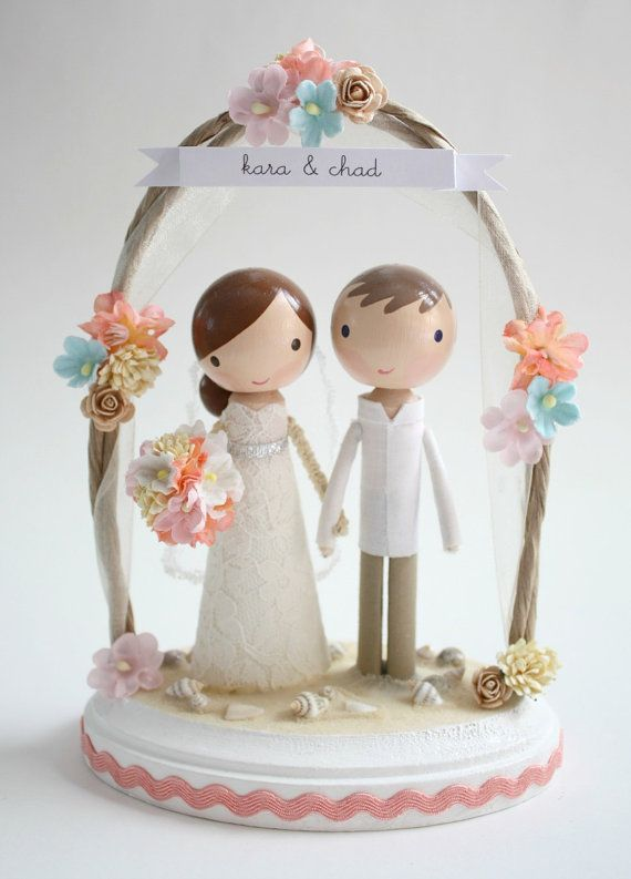 @Crystal Westerwal  OMG how adorable is this? you can get it in purple and its soooo adorable. Its customizable so they make it to match your dress and bouquet and his suit etc.   custom beach wedding cake topper  with arch by lollipopworkshop, $190.00