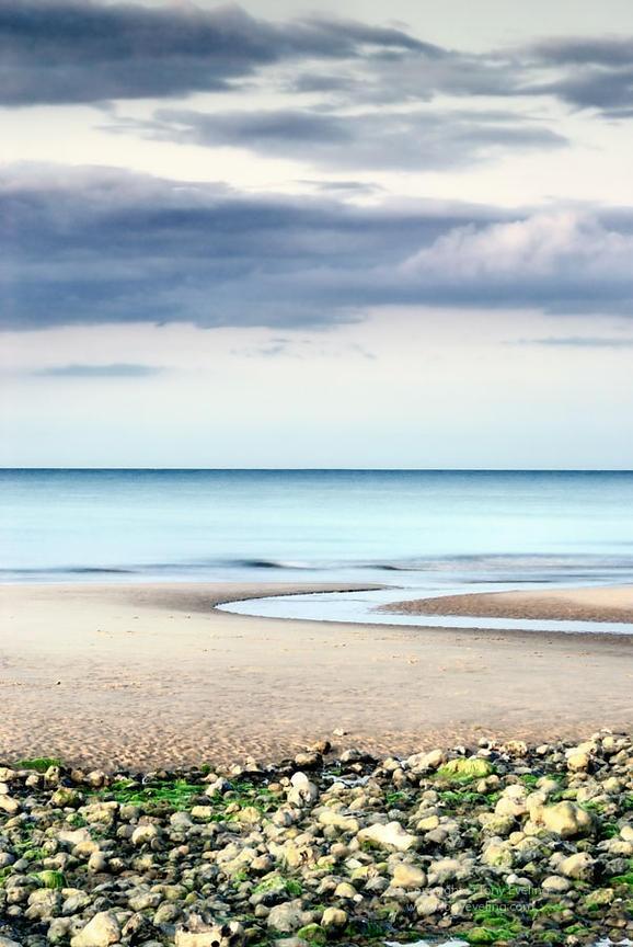 Stunning soft evening light one summer walking along West Runton beach on the north Norfolk coast...
