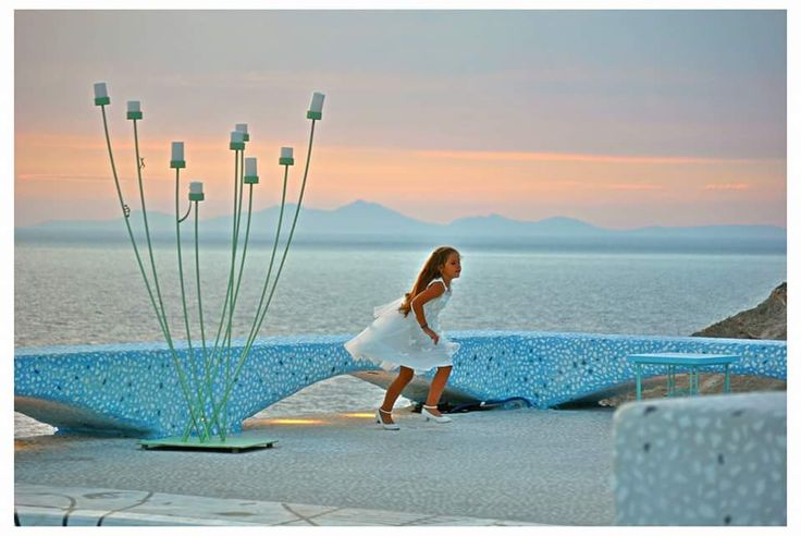 Our young guest in harmony with the sunset scenery during a wedding at Pathos