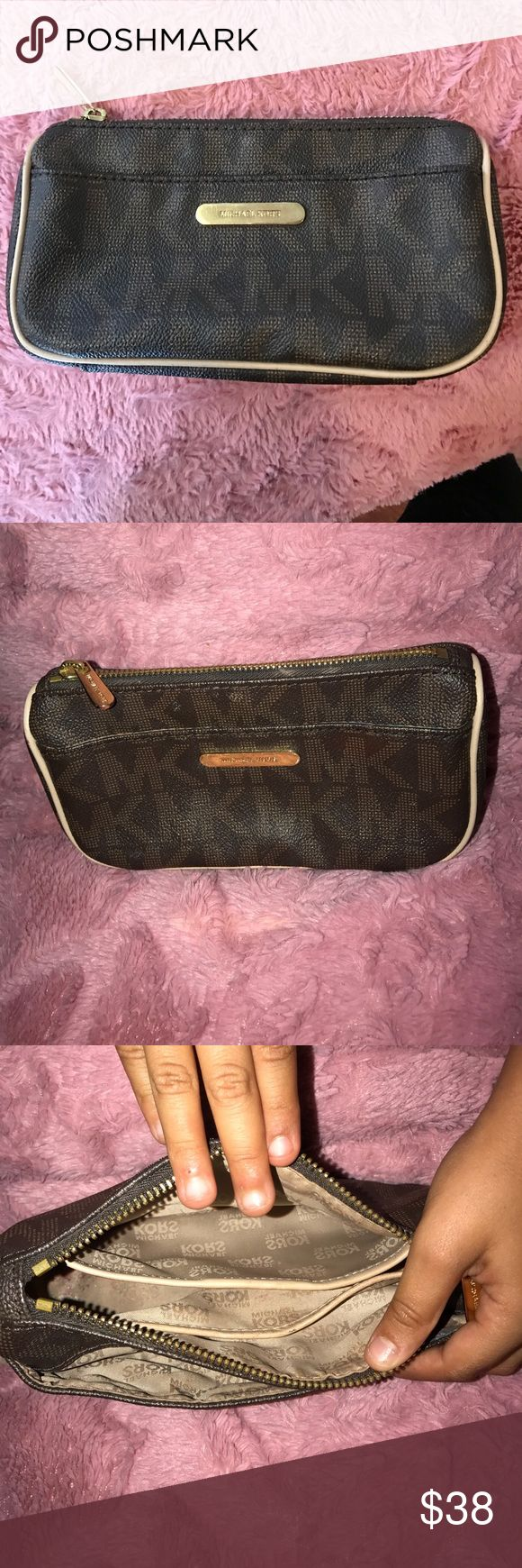 Michael Kors makeup bag Authentic MK makeup bag previous loved makeup stains inside snow makeup marks on front and back like as shown on pictures Michael Kors Bags Cosmetic Bags & Cases
