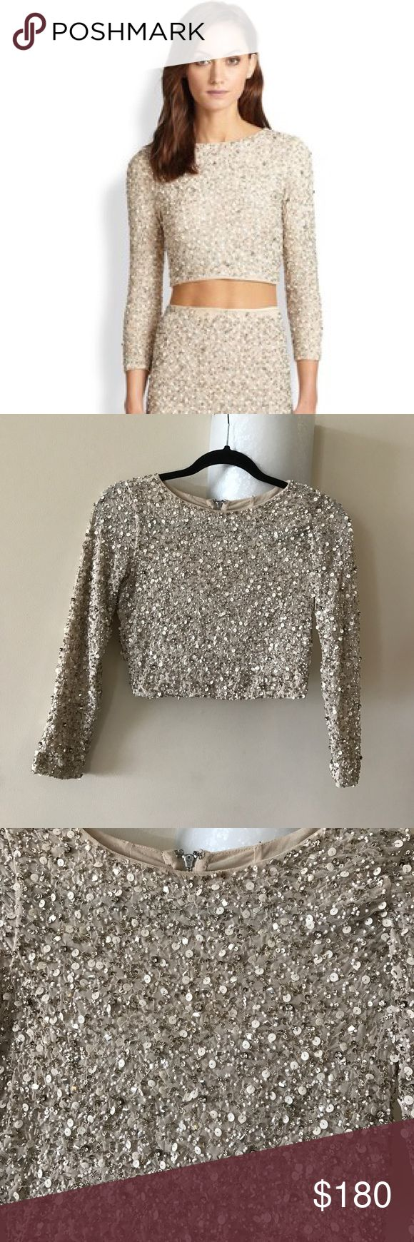 NEW Alice + Olivia Lacey Embellished Beaded Crop NEW with tags! Lacey Embellished Crop Top Stunning sequins and beads embellish a midriff-baring cropped top with exposed back zip. Roundneck. Three-quarter sleeves. Alice + Olivia Tops Crop Tops