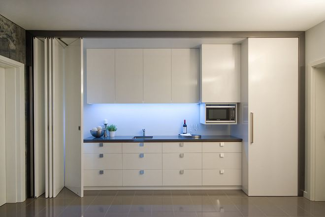 I love the disappearing counter! Contemporary Kitchen by Studio Tonic