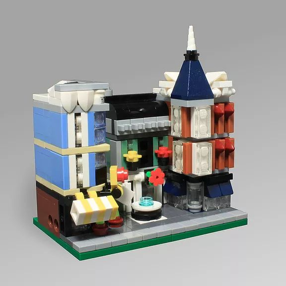 O0ger built mini version of the official LEGO Assembly Square. The model uses all sorts of neat elements to recreate the set at a smaller scale.