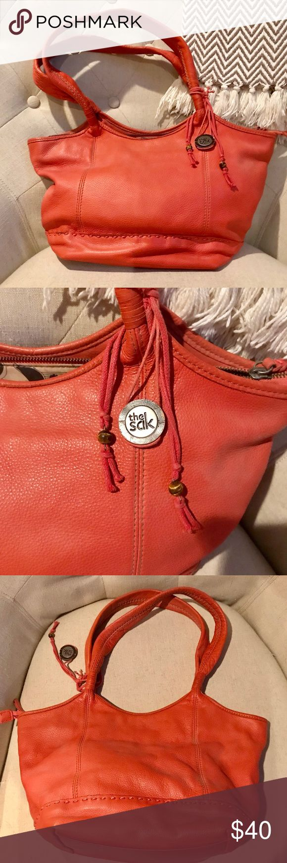 The Sak Shoulder Bag - Make an Offer Burnt Orange Shoulder Bag by The Sak.  In good pre-owned condition.  Handles and body of purse show no signs of wear.  Pictures posted of flaws on bottom of purse. The Sak Bags
