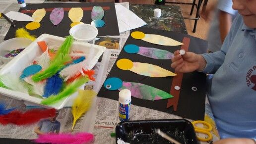 Grade 1 using their own painted papers.