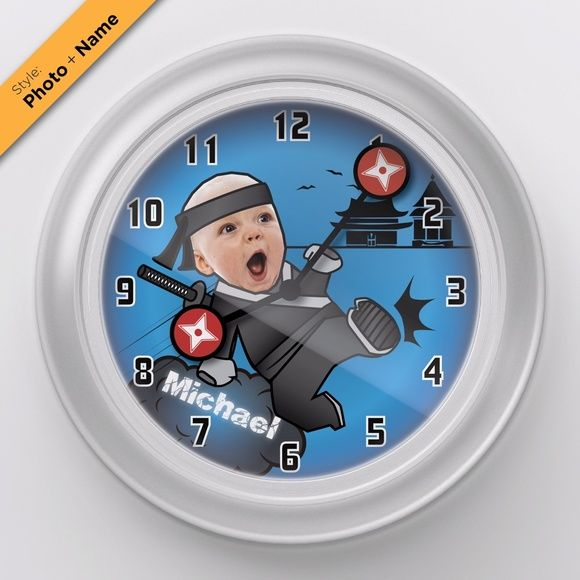 "Personalized Custom Baby Picture Wall Clock Ninja Add your baby's picture to this Ninja themed clock! Watch the shuriken clock arms move around as time goes by.  Simply send me your baby's picture and he will be a swift ninja!  • Clock dimension: 9.5"" x 9.5"" x 1.25"" • Frosted white frame with clear acrylic cover • Takes 1 AA battery (not included) Qclock Accessories Watches"