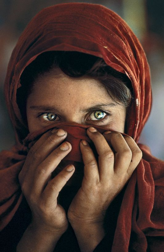 This famous Steve McCurry photograph of a young Afghan girl that adorned the cover of National Geographic magazine and went on to become one of the most famous faces in the world. Here eyes are so haunting.