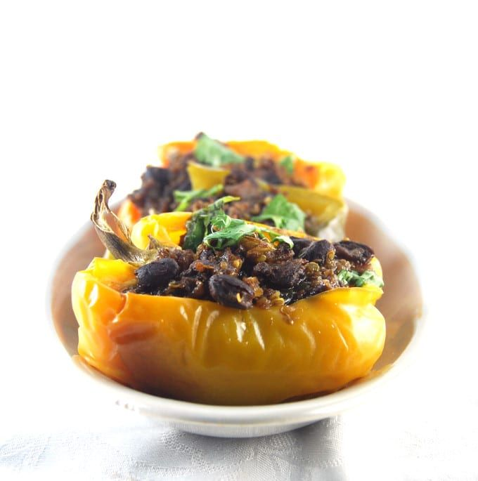 A recipe for Quinoa and Black Bean Stuffed Bell Peppers spiced with biryani masala. A gluten-free, vegan recipe. Flavored with ginger, garlic, and turmeric.
