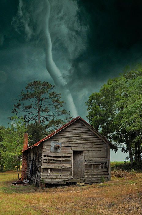 The photographer commented that she rode the tornado out in a ditch that was close, and that most of the building was left standing, but the tin roof was probably in the next county.  She didn't say where this was taken.