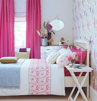 Love the clean, white furniture and bedding paired with bold pink curtains.