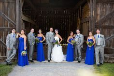 Love the grey suits with the royal blue and yellow! Would be Perfect if the dresses were knee length.