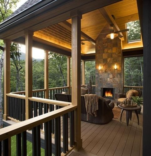 Covered deck with fireplace. This literally looks like my heaven, fireplace? woods? blanket? where is my cup of tea and my perfect man!?