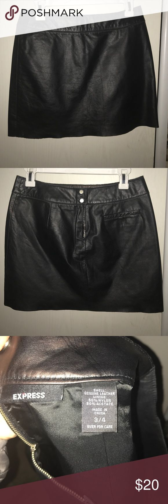 Black Leather Mini Skirt Black leather mini from Express.  Unfinished edges and lined, this skirt zips and buttons in the back.  Size 3/4 Express Skirts Mini