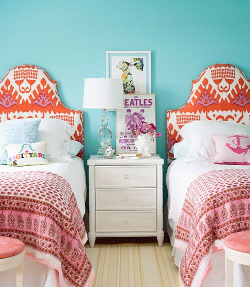 Headboards, upholstered in an ikat print by Quadrille, flank a Bungalow 5 nightstand in the girl's room of this Cape Cod home. Small throw pillows by Jonathan Adler and cotton sari blankets layer on extra personality. The walls are painted Caribbean Cool by Benjamin Moore.   - CountryLiving.com