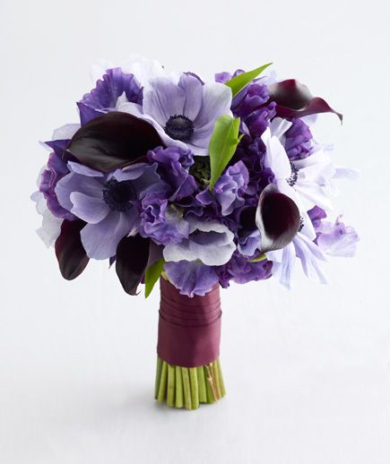 Purple and lavender sweet pea, calla lily, anemone, and hellebores - photo by steve giralt; bouquet by studio sweet pea