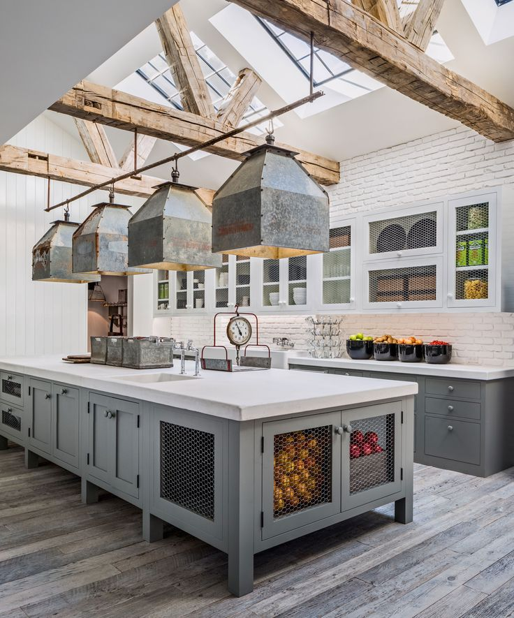 Spacious kitchen with exposed joists and beams, large industrial skylights and pendants over the central island in this home in Los Angeles, California. [2783 × 3348] : RoomPorn