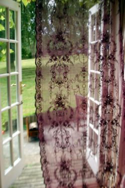 Vintage lace curtains- I don't normally like lace that much, but something about this made me stop and take notice!