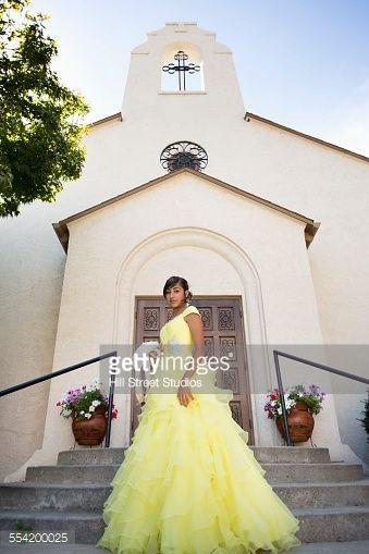 Hispanic Girl Celebrating Quinceanera In Catholic Church Stock ...