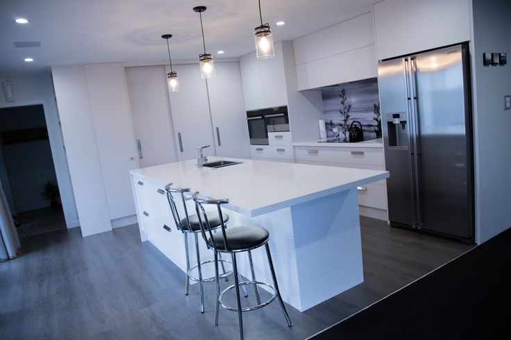 Powell Kitchen featuring Caesarstone Frosty Carrina, Formica Pure Marble and Melteca Alaskan in Puregrain finish