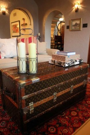 Louis Vuitton Trunk Used As A Table In A Living Area.