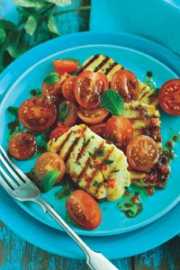 We can't get enough of cremy halloumi. Enjoy this super easy tomato and halloumi salad