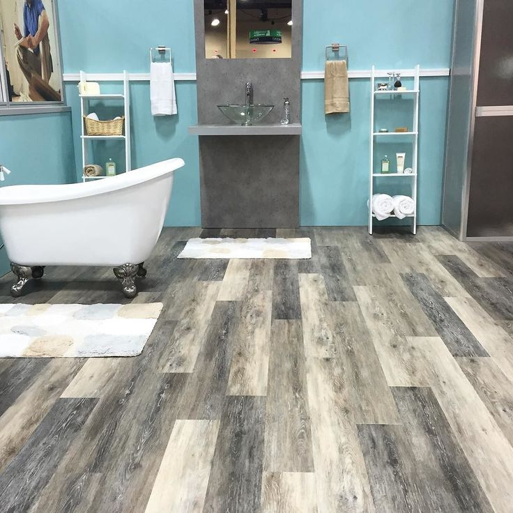 25 best ideas about waterproof flooring on pinterest for Can you put laminate flooring in a bathroom