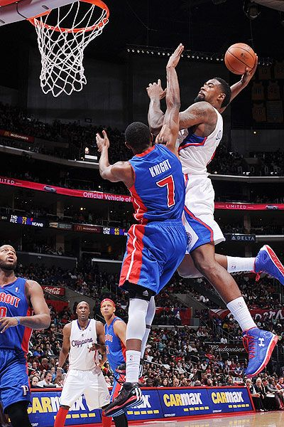 Los Angeles Clippers' center DeAndre Jordan's dunk over Detroit Pistons guard Brandon Knight