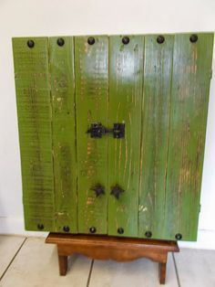 My husband created this rustic dartboard cabinet from reclaimed pallet wood. It comes with a vintage, UNUSED dartboa...