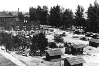 Although the private camps had started renting tent space, their proprietors soon realized that cabins with a few amenities attracted customers. Merrick's Auto Camp in Medford. ca 1930; Courtesy Southern Oregon Historical Society #8940