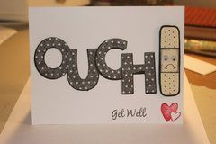 handmade get well card by Alabamachick ...big OUCH in die cut polka dot paper and a bandaid ... little heart in the corner ... clean and simple ... cute card