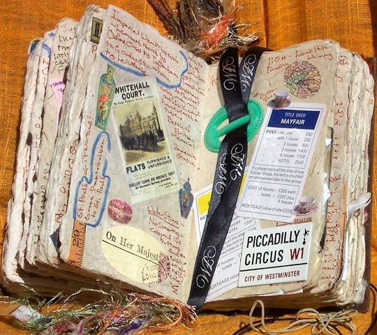 """Mixed-media travel journal.  This would be a really cool idea for field trips.  And I personally love how """"ratty"""" the book looks."""