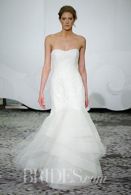 A strapless @rivini wedding dress with a soft mermaid skirt | Brides.com