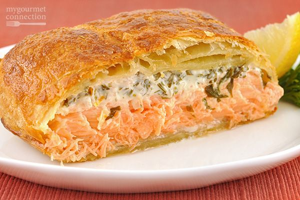 This elegant dish is simply puff pastry-wrapped salmon fillets topped with a mixture of cream cheese, fresh tarragon, parsley and lemon zest.