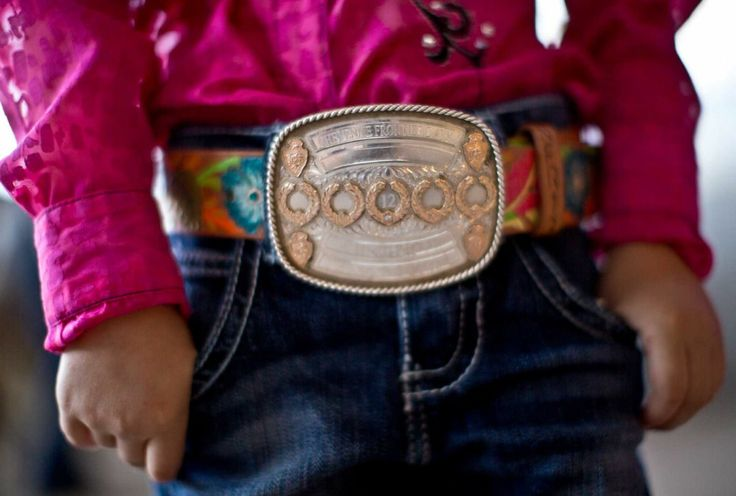 On HoustonChronicle.com: Rodeo competitors show their pride with trophy buckles. Style Brazile, 3, wears a buckle her father, Trevor Brazile, a well-known competitor, gave her.