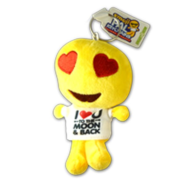 "Take your favorite emoji with you everywhere with a plush emoji pal keychain. This one features a smiling face with heart eyes wearing a t-shirt that says ""I Heart U to the Moon & Back."" Collect them all!"